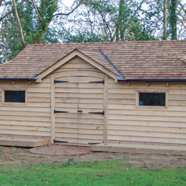 Oak Log Cabin with Cedar Roof in Sevenoaks